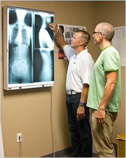 Fredrick helps patient and consults with them on chiropractic care